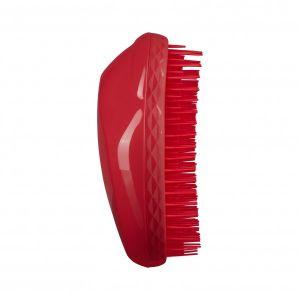 Cheveux épais et bouclés rouge
